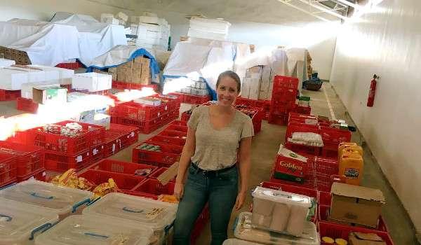Lauren Russell Nkuranga at GET IT's storage facilties